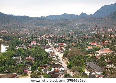 Mount Phousi  in the late afternoon, in time to watch the sun set over Luang Prabang and the surrounding countryside. - stock photo