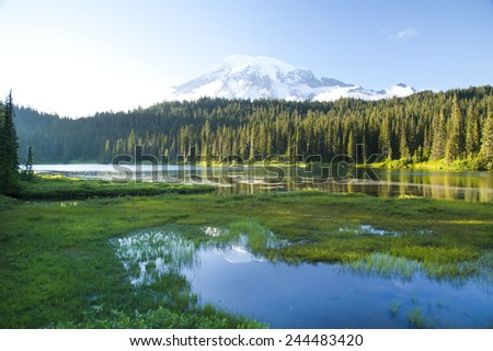 Mount Rainier and Reflection Lake at sun set. Mt. Rainier is the largest American volcano - Washington, USA. - stock photo