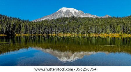 Mount Rainier and Reflection Lake on a Blue Sky Day - stock photo