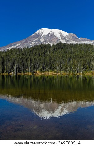 Mount Rainier and Reflection Lake on a sunny day - stock photo