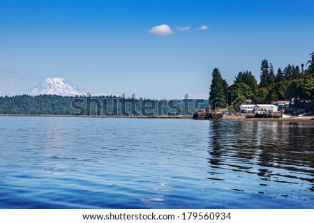 Mount Rainier reflected in the waters of the southern end of Puget Sound - stock photo