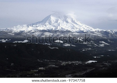 Mount Rainier, the tallest peak in Washington state, covered in snow. - stock photo