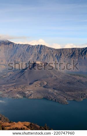 Mount Rinjani crater lake with Gunung Barujaru active cone - stock photo
