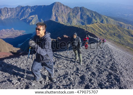 MOUNT RINJANI, LOMBOK, INDONESIA - JUNE 13, 2015 : Unidentified mountaineers hike on their way to the peak. Rijani mountain is one of the highest mountains in Indonesia