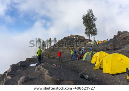 MOUNT RINJANI, LOMBOK, INDONESIA- SEPT 18, 2016: A group of mountain climbers camped at Pelawangan Sembalun while enjoying the nature. Rijani mountain is one of the highest mountains in Indonesia