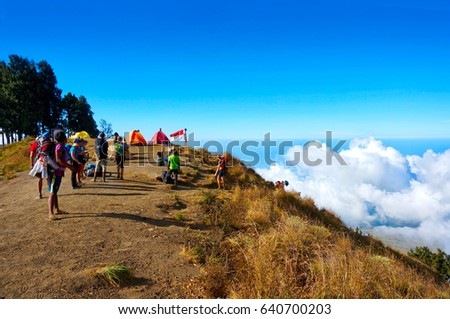 MOUNT RINJANI, LOMBOK, INDONESIA- SEPT 18, 2016: A group of mountain climbers camped at Pelawangan Sembalun while enjoying the nature. Rinjani mountain is one of the highest mountains in Indonesia