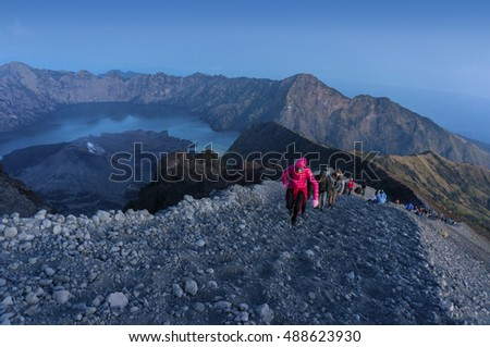 MOUNT RINJANI, LOMBOK, INDONESIA - SEPT 19, 2016 : Unidentified mountaineers hike on their way to the peak. Rinjani mountain is one of the highest and prettiest mountains in Indonesia