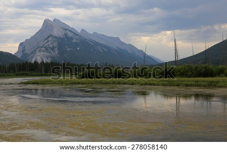 Mount Rundle and one of the Vermilion lakes in the foreground.  Located in Banff National Park, Alberta, Canada.  - stock photo