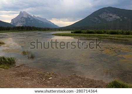 Mount Rundle and Sulphur Mountain reflecting in the the Vermilion lakes.  Located in Banff National Park, Alberta, Canada.  - stock photo