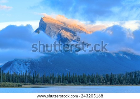 Mount Rundle is a mountain in Canada's Banff National Park overlooking the towns of Banff and Canmore, Alberta. - stock photo