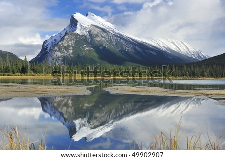 Mount Rundle reflected in the mirror  Vermillion Lakes Banff - stock photo