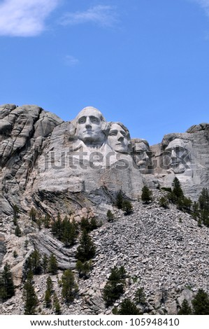 Mount Rushmore National Memorial in South Dakota features sculptures of former U.S. presidents George Washington, Thomas Jefferson, Theodore Roosevelt and Abraham Lincoln. - stock photo