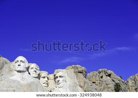 Mount Rushmore National Memorial, symbol of America located in the Black Hills, South Dakota, USA. Image created with extra blue space for added text or for presentations. - stock photo