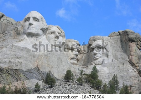 Mount Rushmore National Memorial The sixty foot faces of past United States President's.  George Washington, Thomas Jefferson, Theodore Roosevelt,Abraham Lincoln carved in granite. - stock photo