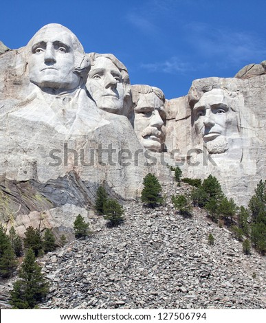 Mount Rushmore National Monument in South Dakota.  Vertical image on a clear day. - stock photo