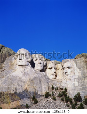 Mount Rushmore National Monument showing the faces of George Washington, Thomas Jefferson, Theodore Roosevelt, and Abraham Lincoln. - stock photo