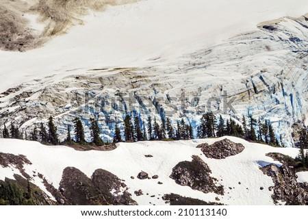 Mount Shuksan Glacier Evergreens Artist Point Mount Baker Highway Snow Mountain Washington State Pacific Northwest  - stock photo