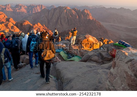 MOUNT SINAI, EGYPT - NOVEMBER 25:  Pilgrims and tourists on the pathway from the Mount Sinai peak (Holy Mount Moses) in early morning on November 25, 2010.  - stock photo