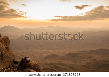 MOUNT SINAI, EGYPT - October 13: Pilgrims and tourists from the Mount Sinai peak (Holy Mount Moses) in early morning on October 13, 2014. - stock photo