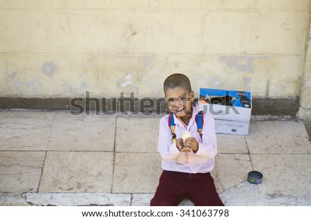 MOUNT SINAI, EGYPT - October 30, 2015: Portrait of unknown Smiling Boy with Spring Chick