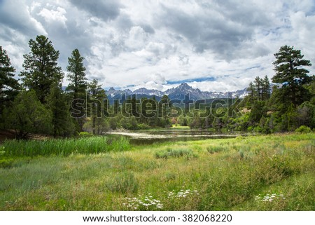 Mount Sneffels Range as seen from Dallas Creek Road, beautiful landscape with pond, in the San Juan Mountains, Colorado - stock photo