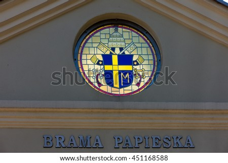 Mount St. Anna, Poland - July 7, 2016: Arms Pope St. John Paul II on the wall of the Basilica of St. Anne of Mount St. Anna, Poland. Papal gate. - stock photo