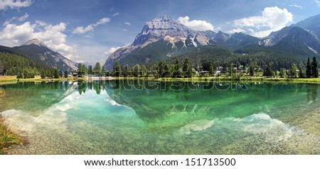 Mount Steven reflects into pond at Field, British Columbia, Canada Located in Yoho National Park. - stock photo