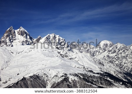Mount Ushba in winter at wind sunny day. Caucasus Mountains. Svaneti region of Georgia. - stock photo