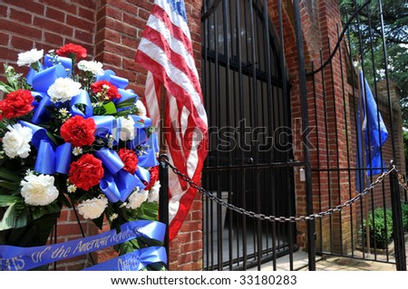 MOUNT VERNON - July 4: George Washington's grave in Mt Vernon, Virginia is decorated to celebrate the U.S. Independence Day on July 4, 2009. Mount Vernon is Washington's former home. - stock photo