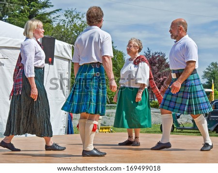 MOUNT VERNON, WA/USA - JULY 9, 2010: These adults are demonstrating tradition Scottish folk dance at the annual Scottish Highland games to bring cultural awareness to the community. - stock photo