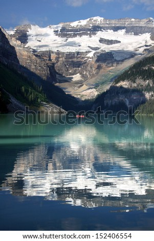 Mount Victoria, Lake Louise, Banff National Park, Alberta, Canada.   Canoeing on Lake Louise. - stock photo