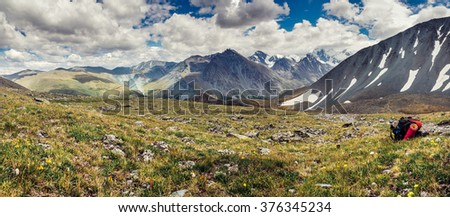Mountain adventure, backpack at the top of the Pass in Altai mountains - stock photo