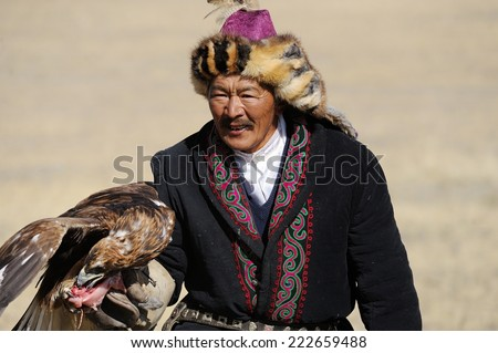 Mountain Altai, Russia - September 21, 2014: the hunter with an eagle at the festival: Berkut-wing Chu steppe - stock photo
