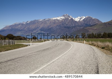 Mountain and farm on scenic road form Queenstown to Glenorchy, New Zealand