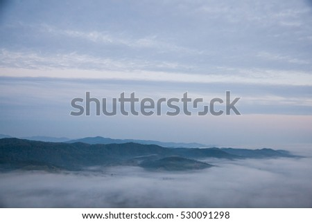 Mountain and fogsea