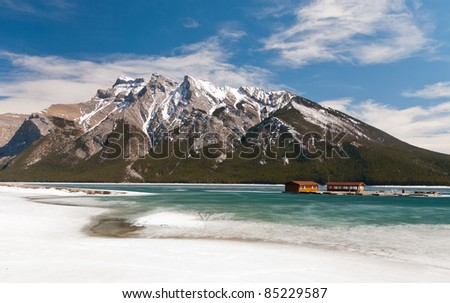Mountain and lake in Canada with frozen water - stock photo