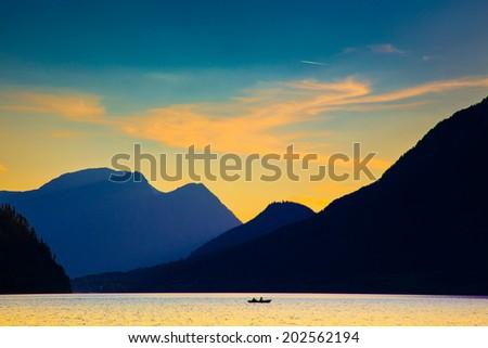 Mountain and lake in high Alps Austria - stock photo