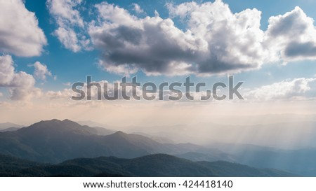 Mountain and sky with clouds background