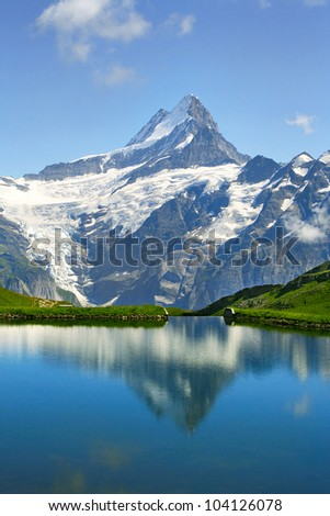 Mountain Bachalpsee In Swiss Bernese Alps - World Heritage Site by UNESCO - stock photo