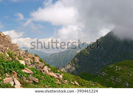 Mountain. Beautiful mountain landscape. Mountain in clouds. Mountain horizon. Amazing mountain. Mountain before storm. Sochi. Russia. - stock photo