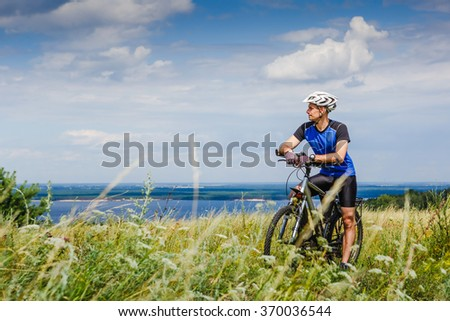 Mountain Bike cyclist on sunny day. healthy lifestyle active athlete  - stock photo