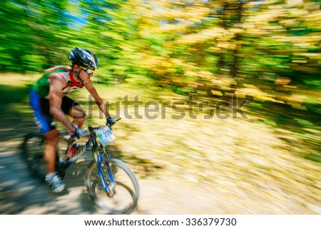 Mountain Bike cyclist riding track at sunny day, healthy lifestyle active athlete doing sport. - stock photo