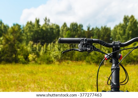 mountain bike in the field on forest background