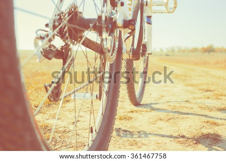 Mountain bike on the dirt road - wide angle view - stock photo