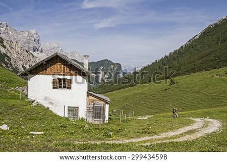 Mountain bike tour to Hallerangeralm in Karwendel mountains - stock photo