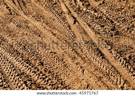 Mountain Bike Tracks in Mud Background - stock photo