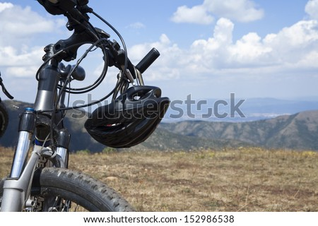 mountain bike with helmet, landscape close up