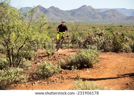 Mountain Biker on Desert Trail - stock photo