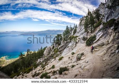 Mountain biker on the Tahoe Flume Trail. - stock photo