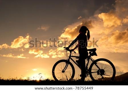 Mountain biker Woman silhouette - stock photo